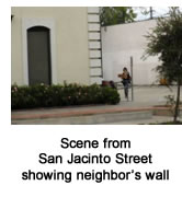 Scene from San Jacinto Street showing neighbor's wall