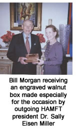 Bill Morgan receiving an engraved walnut box made especially for the occasion by outgoing HAMFT president Dr. Sally Eisen Miller
